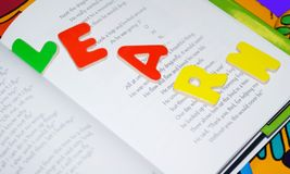 Read To Learn. Block letters on top of a children's book.  This is a book I wrote and published Stock Photo