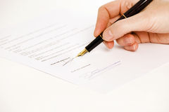 Read and understood signature. Someone signing a document with a pen. text is blur. Only read and understood and the signatture are visible. Isolated on white stock image