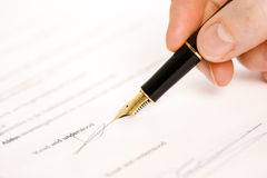 Read and understood signature. Someone signing a document with a pen. text is blur. Only read and understood and the signatture are visible. Isolated on white stock photography