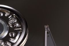 Read-write hard drive head. Closeup of the read-write head of a computer hard drive. Black background stock image