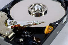 Read and write head of a open harddisk drive. Opened hard disk drive shows the disc and the read and write head. focus on the read and write head Stock Photography