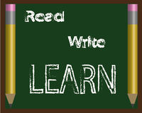 Read Write Learn. Read, Write, and Learn written on a chalkboard.  Two Pencils border each side of the board Stock Image