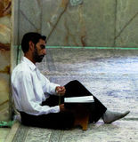 Reader in Iranian Mosque. Muslim Man reading religious text in an Iranian mosque Stock Photography