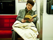 Reader in subway. Elderly is reading in the subway, Nagoya Japan Royalty Free Stock Image