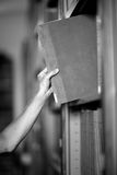 Reader taking a book from shelve Stock Images