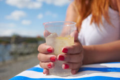 Readhead girl holding cup Royalty Free Stock Photography