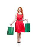 Readhead with green shopping bags Stock Photo