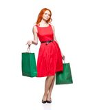 Readhead with green shopping bags Royalty Free Stock Photos