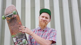 Readhead Hipster in Hat With a Skateboard stock footage