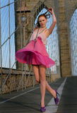 Readhead model dancing wearing pink chiffon dress Stock Photo