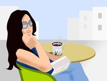 Readig Girl with Sunglasses. A young girl sitting by a table with a cup of tea or coffee and holding a book in her hand Royalty Free Stock Photo