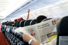 Readin a newspaper Stock Images