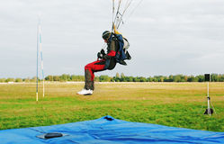 Readiness for a parachutist landing Royalty Free Stock Photo