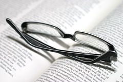 Reading. Glasses on an opened book. macro, shallow DOF royalty free stock photography