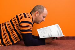 Reading 1. Casual man reading a magazine - pages are blurred you can put anything you want in place royalty free stock photo