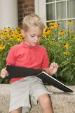 Reading. Young boy reading stock photography