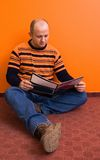 Reading 3. Man in his early 30s, reading a magazine stock photos