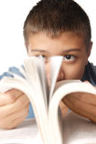 Reading. Photo of the young boy with interesting book Royalty Free Stock Photos