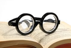 Reading. Photo of Bifocals on a Book - Reading Concept Stock Photography