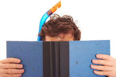 Reading. Man in diving equipment is reading book Royalty Free Stock Photos