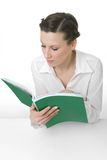 Reading. Happy young woman reading a big book royalty free stock photography