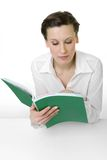 Reading. Happy young woman reading a big book royalty free stock photo