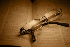 Reading. Glasses over a book Royalty Free Stock Photo