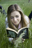 Reading. Girl reading a book outdoor Stock Image