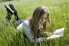 Reading. Girl reading a book outdoor Stock Photos