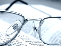 Reading. Shot of a book and eyeglasses royalty free stock images