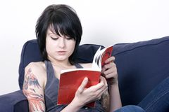 Reading. Young Woman reading Royalty Free Stock Photo