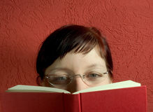 Reading. Woman reading a book Royalty Free Stock Photography