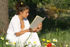 Reading. Girl reading book in summer Royalty Free Stock Photo