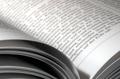 Reading. Inner column of an open book right down Royalty Free Stock Photography