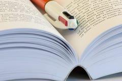 Reading. Book and pen stock photos