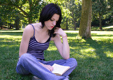 Reading. Student learning in nature Royalty Free Stock Photography