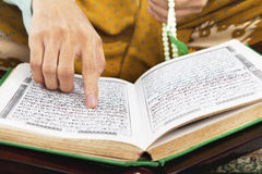 Reading al-quran Royalty Free Stock Photo