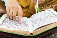 Reading al-quran Royalty Free Stock Photo