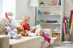 Reading Aloud to Little Sister Royalty Free Stock Photos