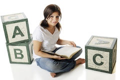 Reading Among the Alphabet Stock Images