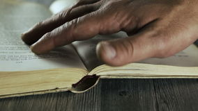 Reading an antique book stock footage