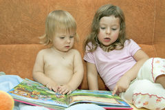 Reading for the baby Stock Photos