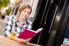 Reading at the bar Royalty Free Stock Image