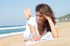 Reading on beach Stock Photos