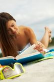 Reading on the beach Royalty Free Stock Photo