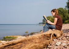 Reading at the beach Stock Photos