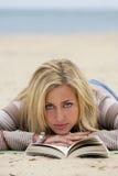 Reading At The Beach Royalty Free Stock Photos