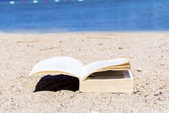 Reading on the beach Stock Images