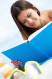 Reading on the beach Royalty Free Stock Photography