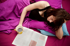 Reading in bed royalty free stock photos